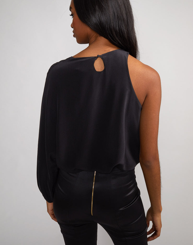 Back view of model wearing Aurora one sleeve top.