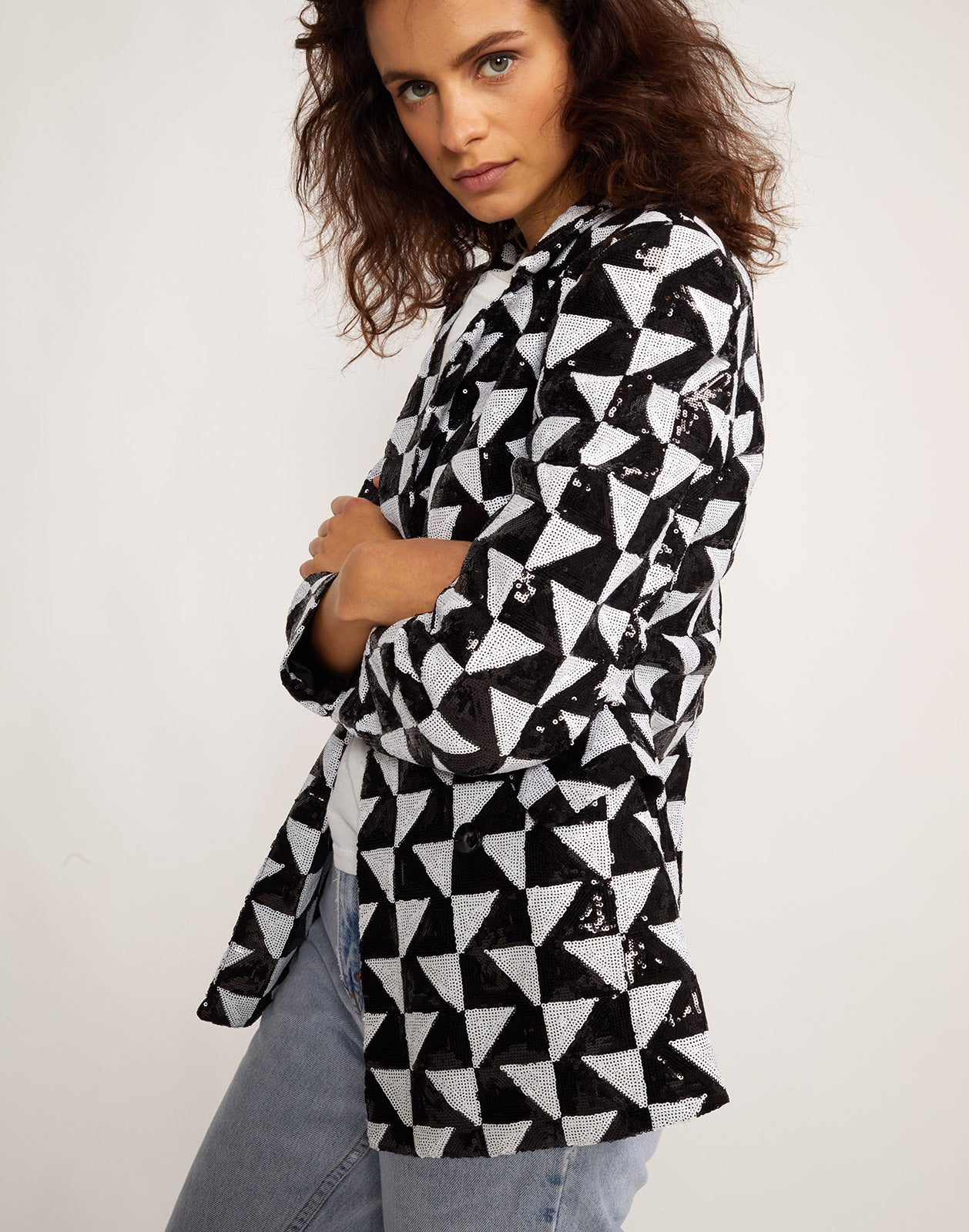 Close side view of the Illusion geometric sequin blazer.