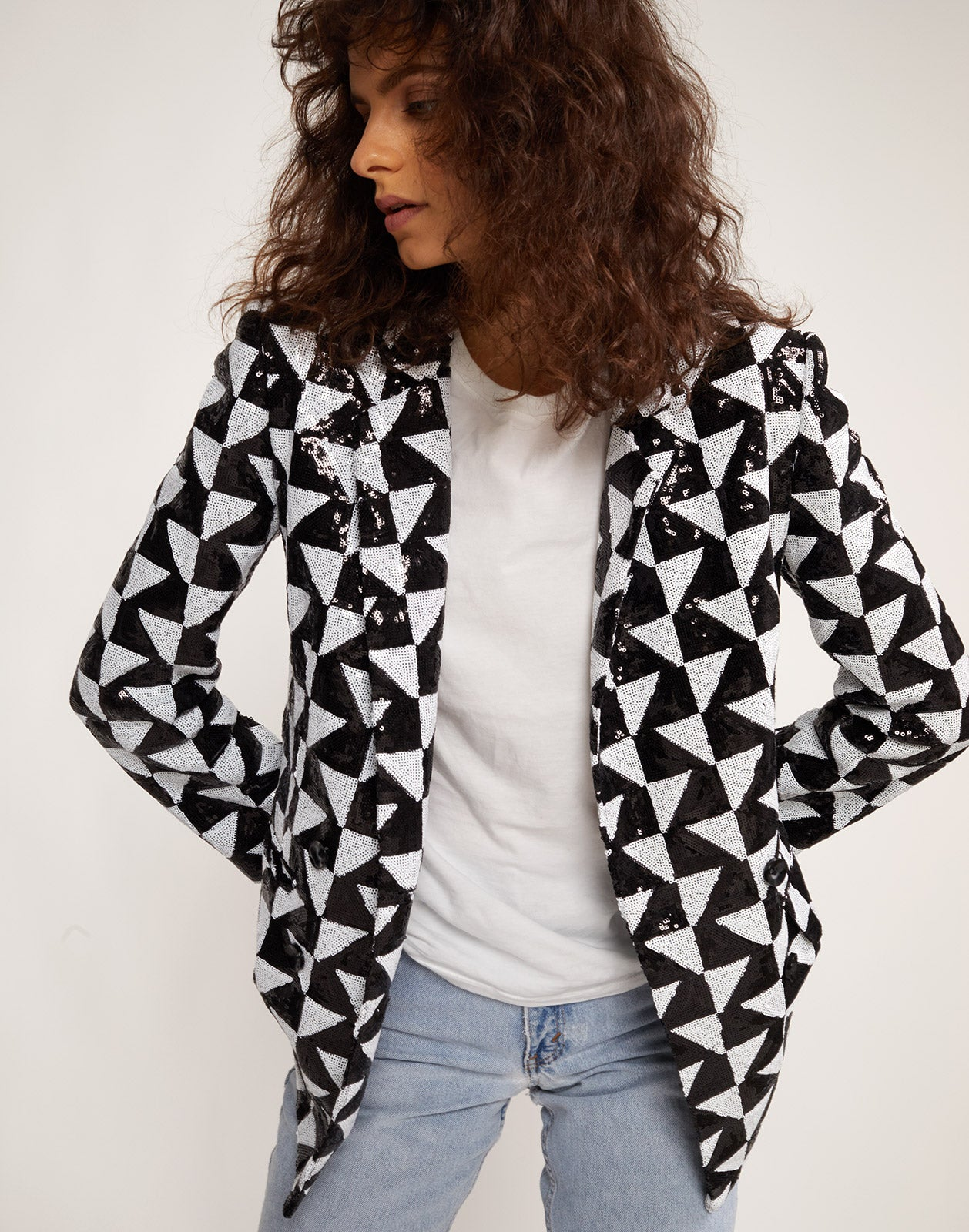 Illusion geometric sequin blazer worn with a white t-shirt.