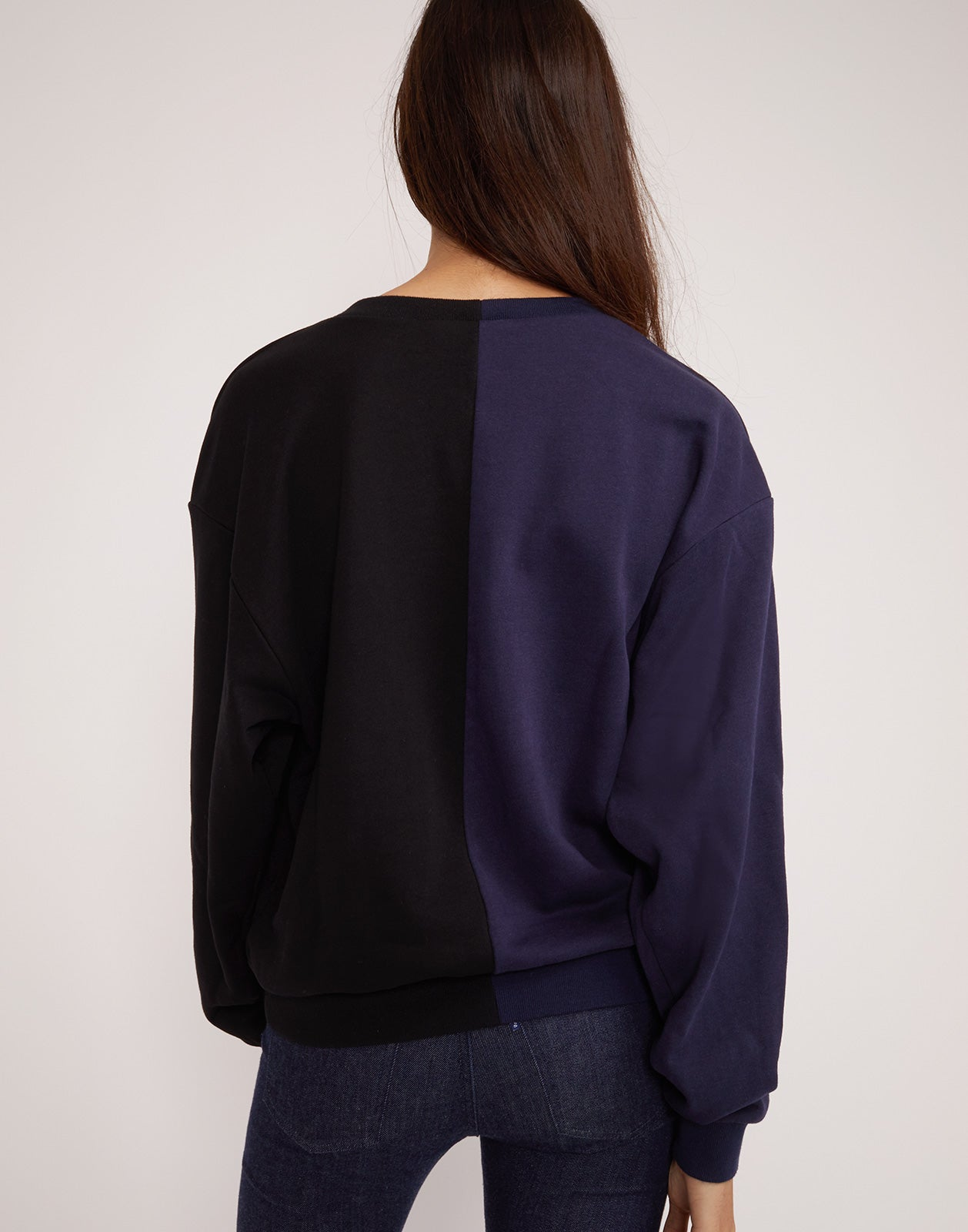 Back view of the CaliYork sweatshirt in half navy half black.