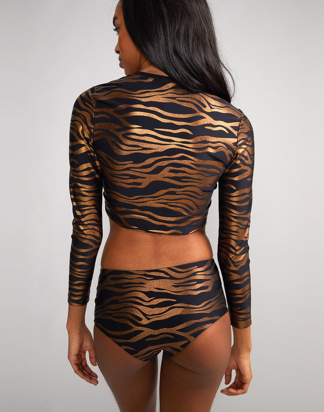 Back view of zebra sasha crop rashguard