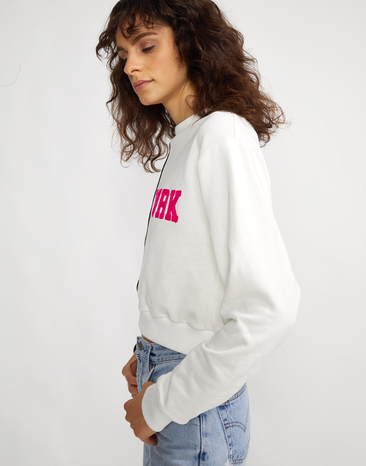 Side view of the black and white CaliYork sweatshirt with hot pink lettering.