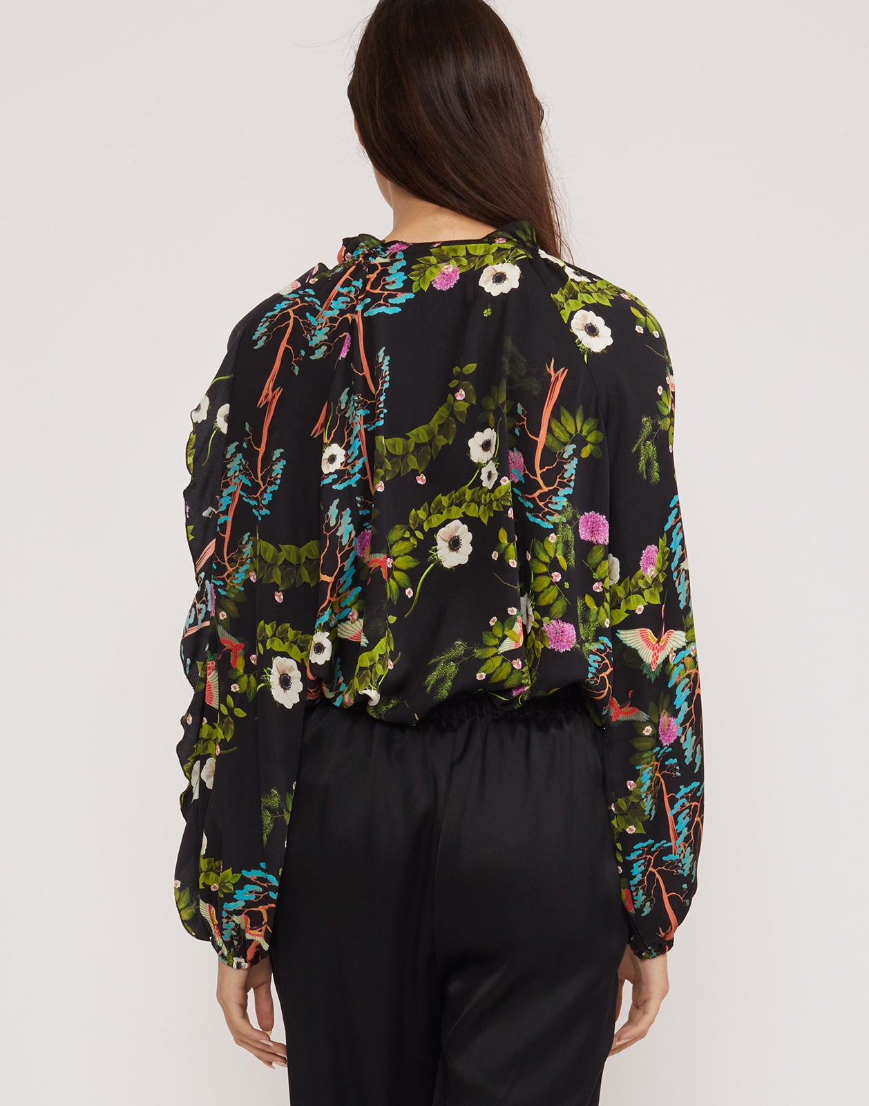 Back view of Windsor blouse in dark floral print.
