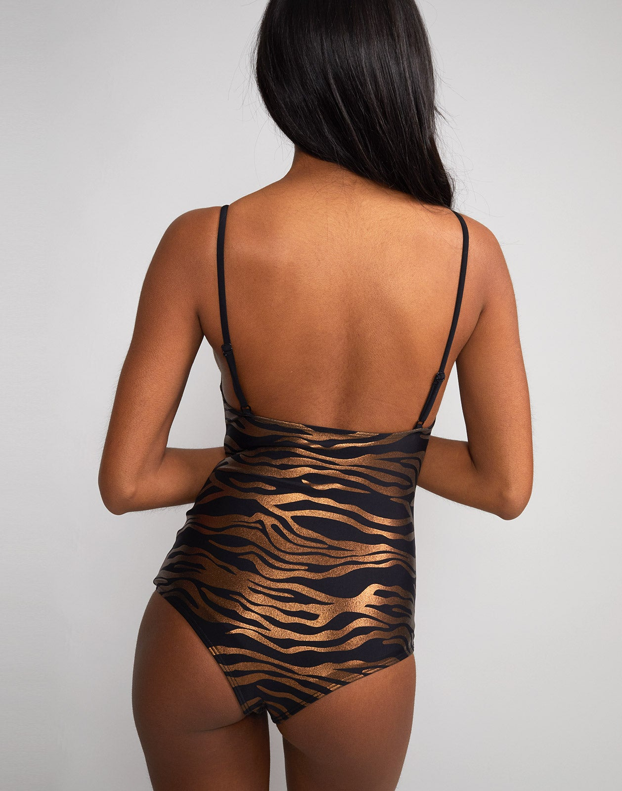 Back view of zebra sandi one piece swimsuit