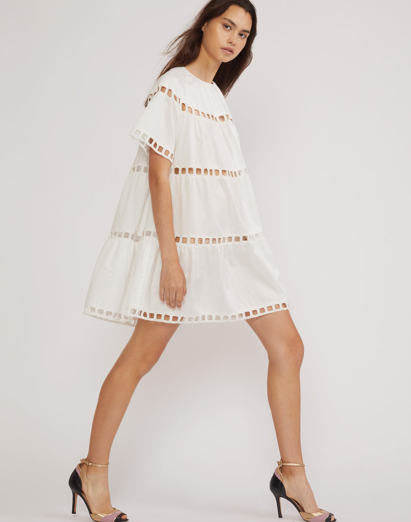 Side view of the white eyelet Postcard dress.