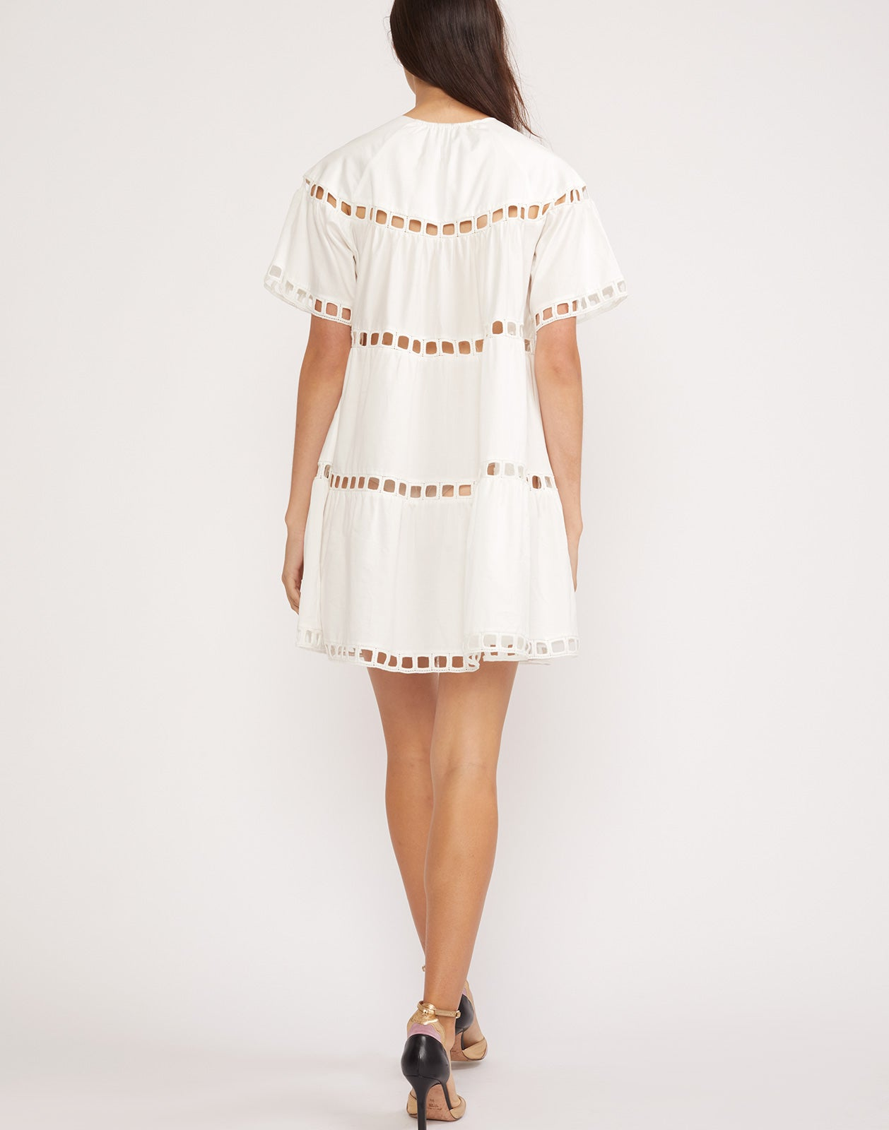 Back view of the white eyelet Postcard dress in polished cotton.