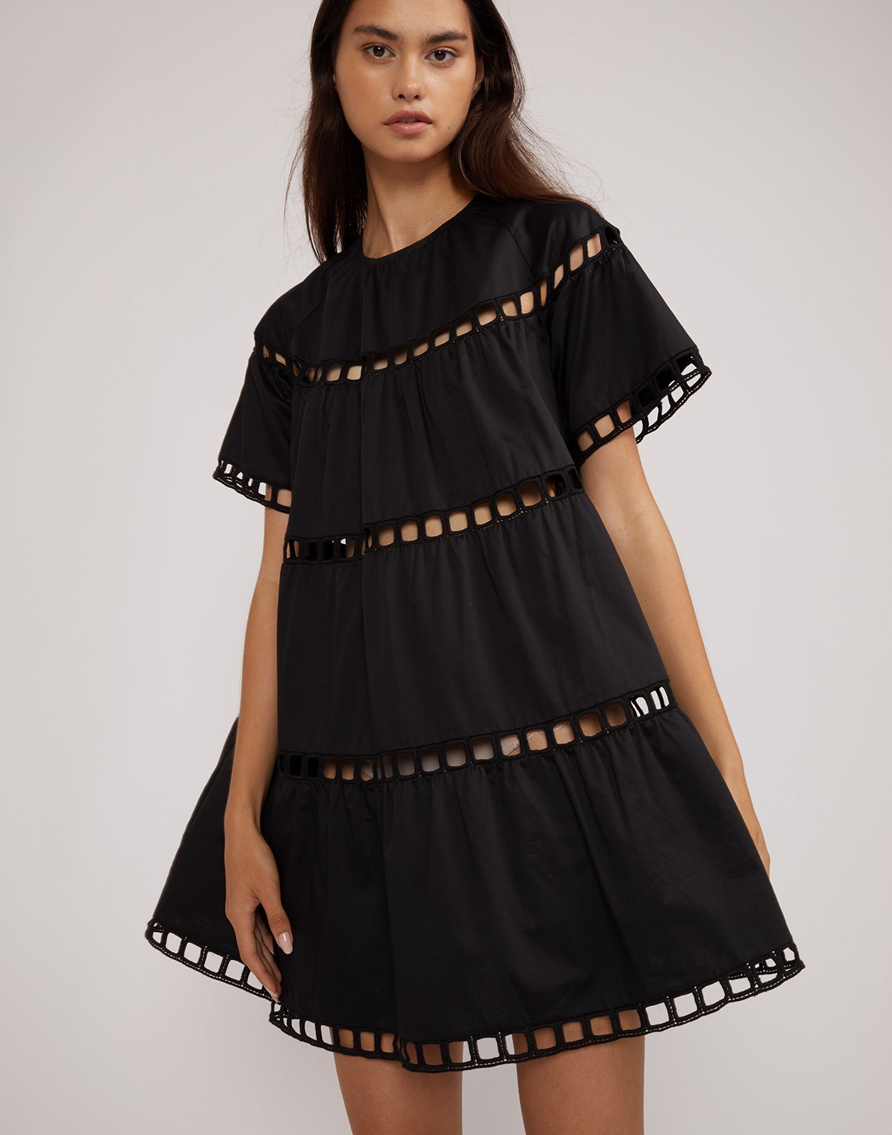 Close front view of the black cotton eyelet swing dress.
