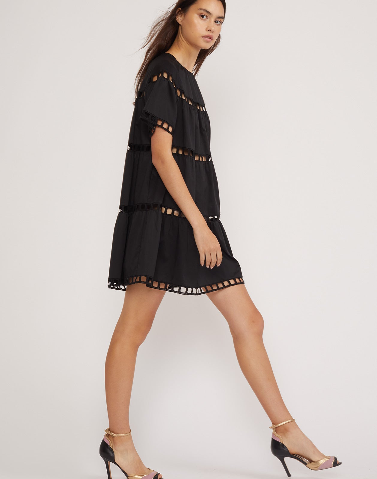 Full side view of the black Postcard eyelet dress in cotton.
