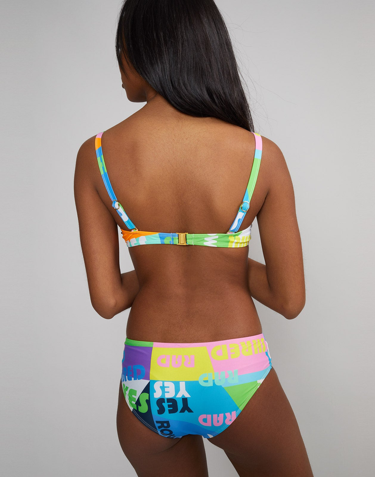 Back view of low rise bikini bottom in good vibes print