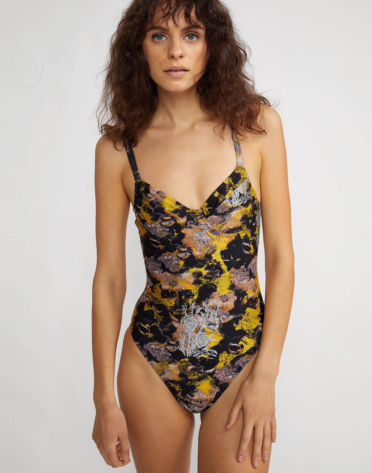 Front view of metallic floral one piece swimsuit with underwire bralette and adjustable straps.