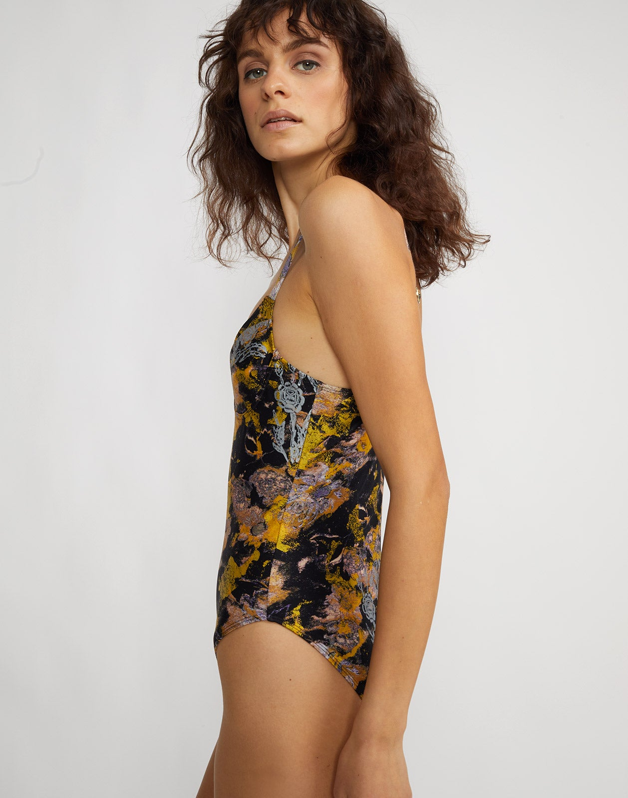 Side view of metallic floral one piece swimsuit with underwire bralette and adjustable straps.