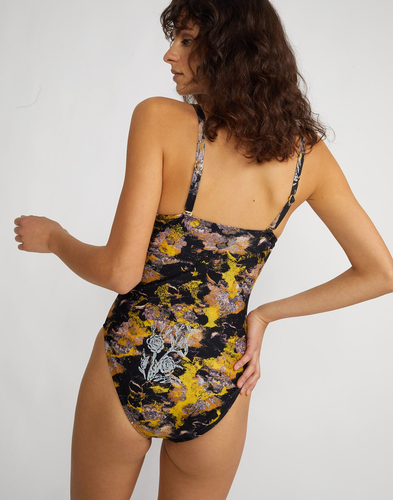 Back view of metallic floral one piece swimsuit with underwire bralette and adjustable straps.