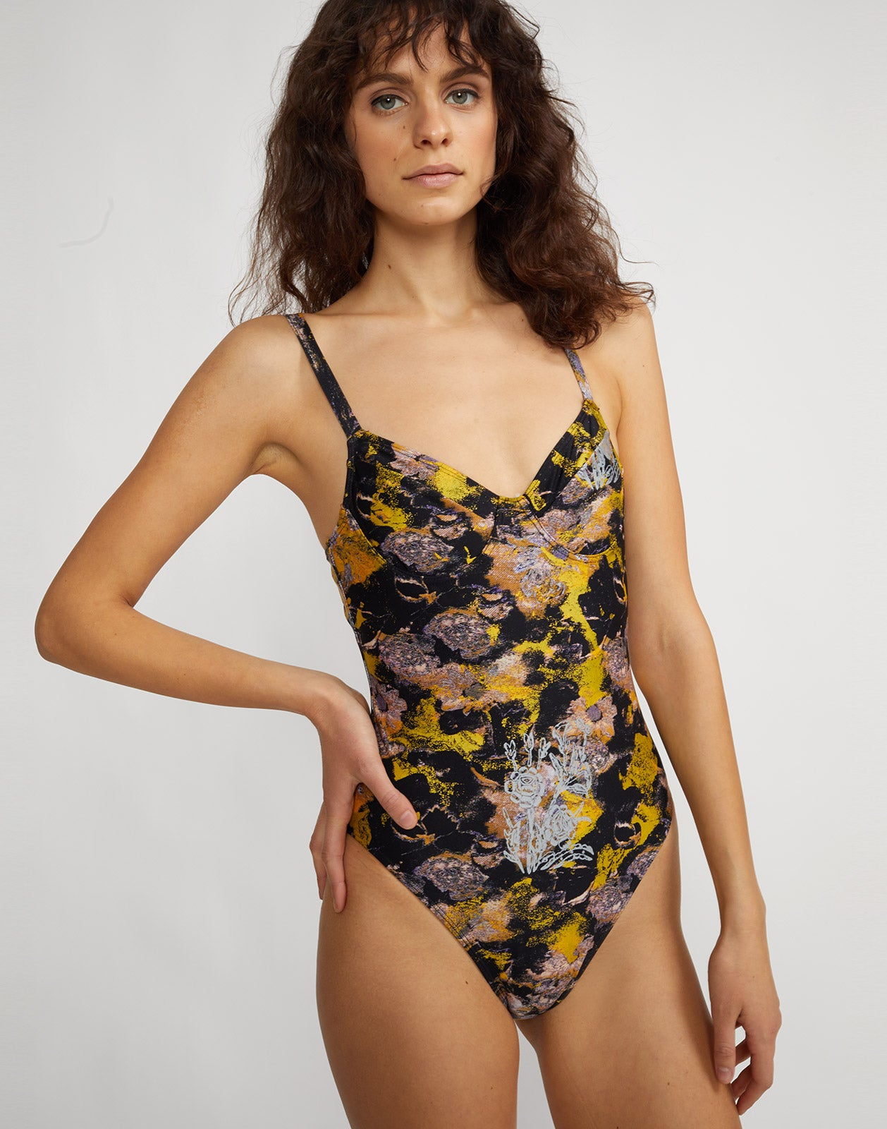 Front angled view of metallic floral one piece swimsuit with underwire bralette and adjustable straps.