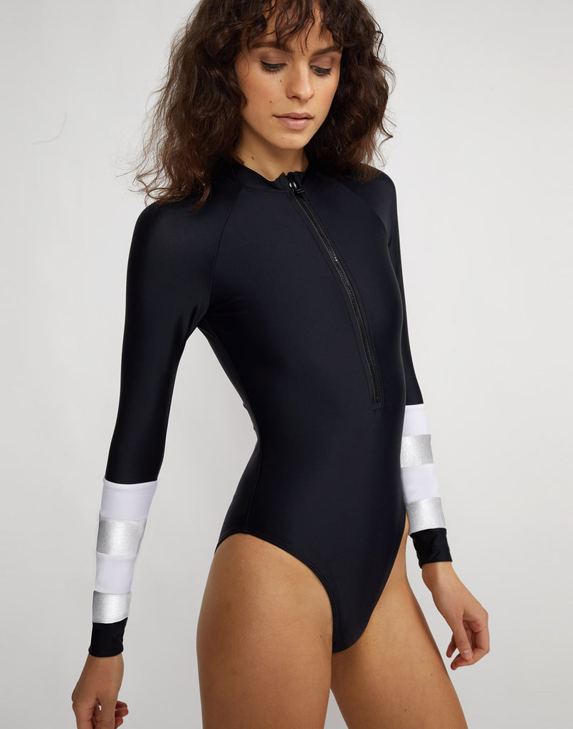 Side view of the silver stripe Hepburn surfsuit.