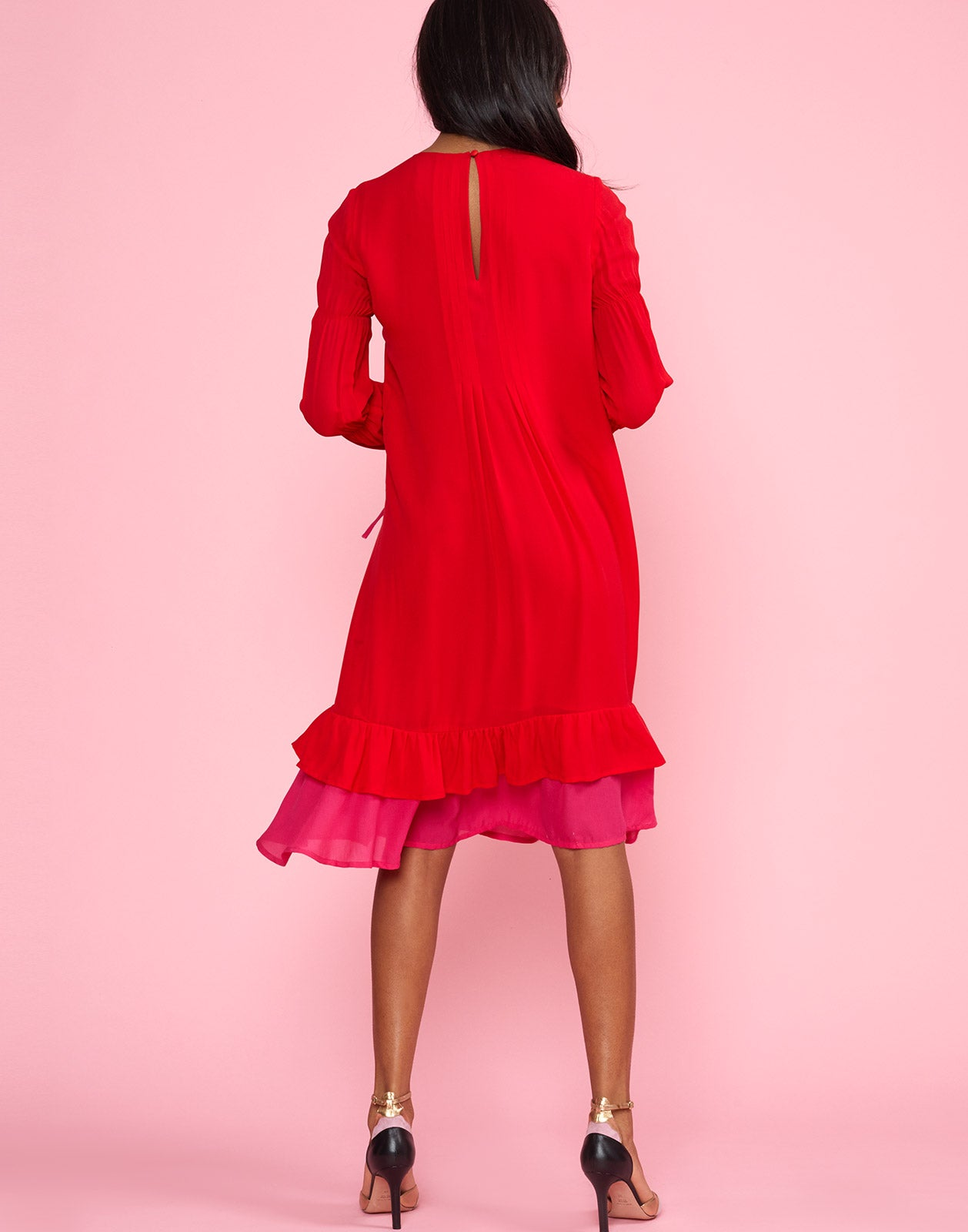 Full back view of model wearing Isla Pinktuck Dress in cherry red.