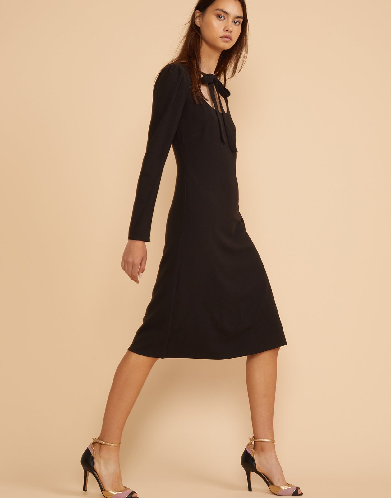 Side view of the Waverly neck tie dress in black crepe.