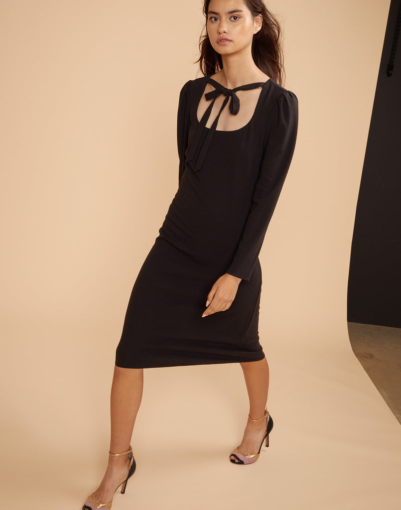 Model walking in the Waverly crepe dress in black.