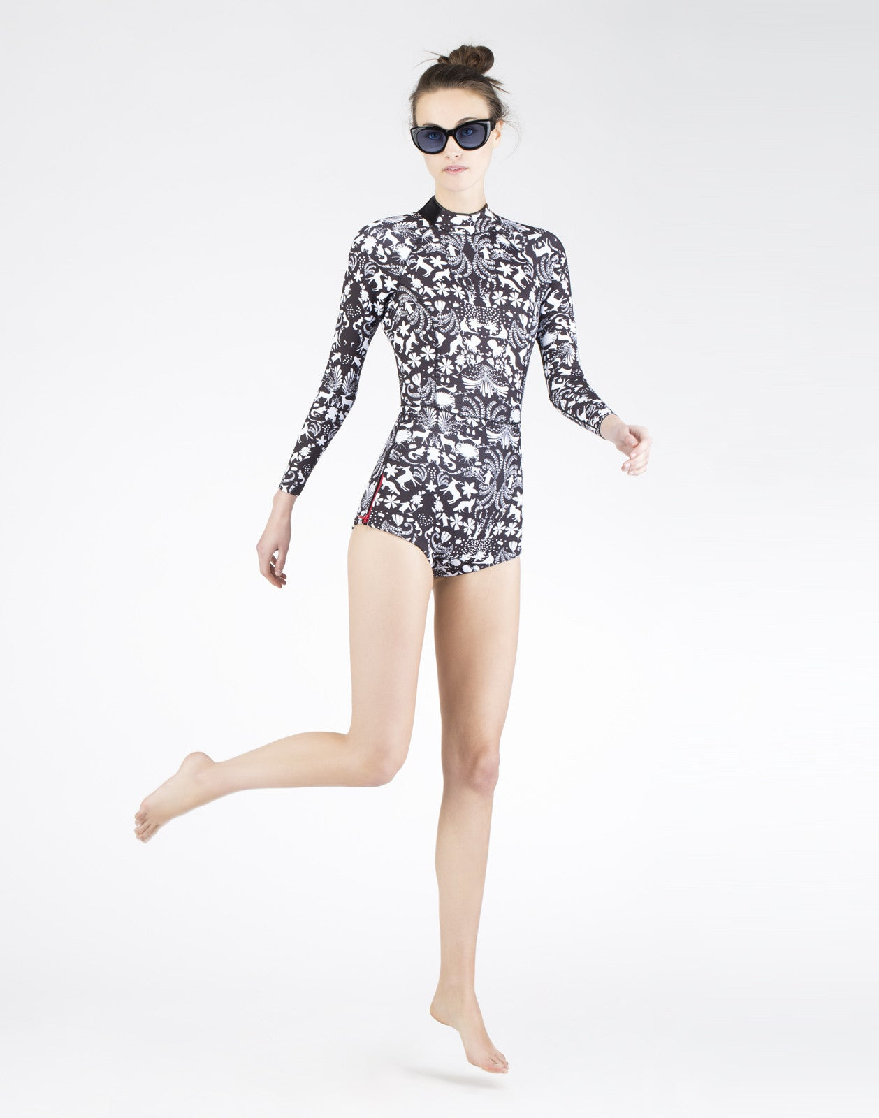 Full front view of the 2mm neoprene wetsuit in wildlife print.