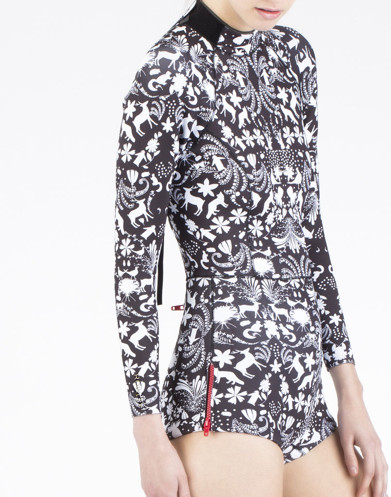 f009b5985744 Angled front view of the 2mm neoprene wetsuit in wildlife print.