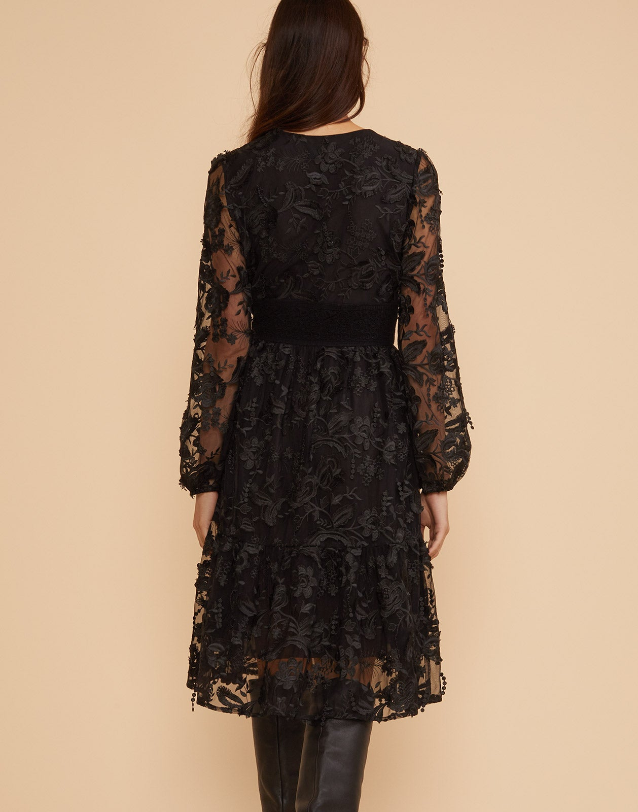 Back view of the harlow black lace dress with neck tie detail.