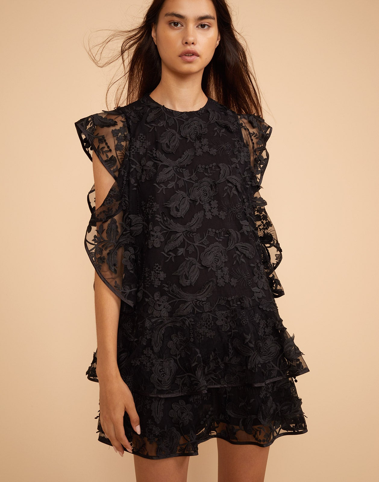 Close front view of the Madison floral lace flutter sleeve dress.