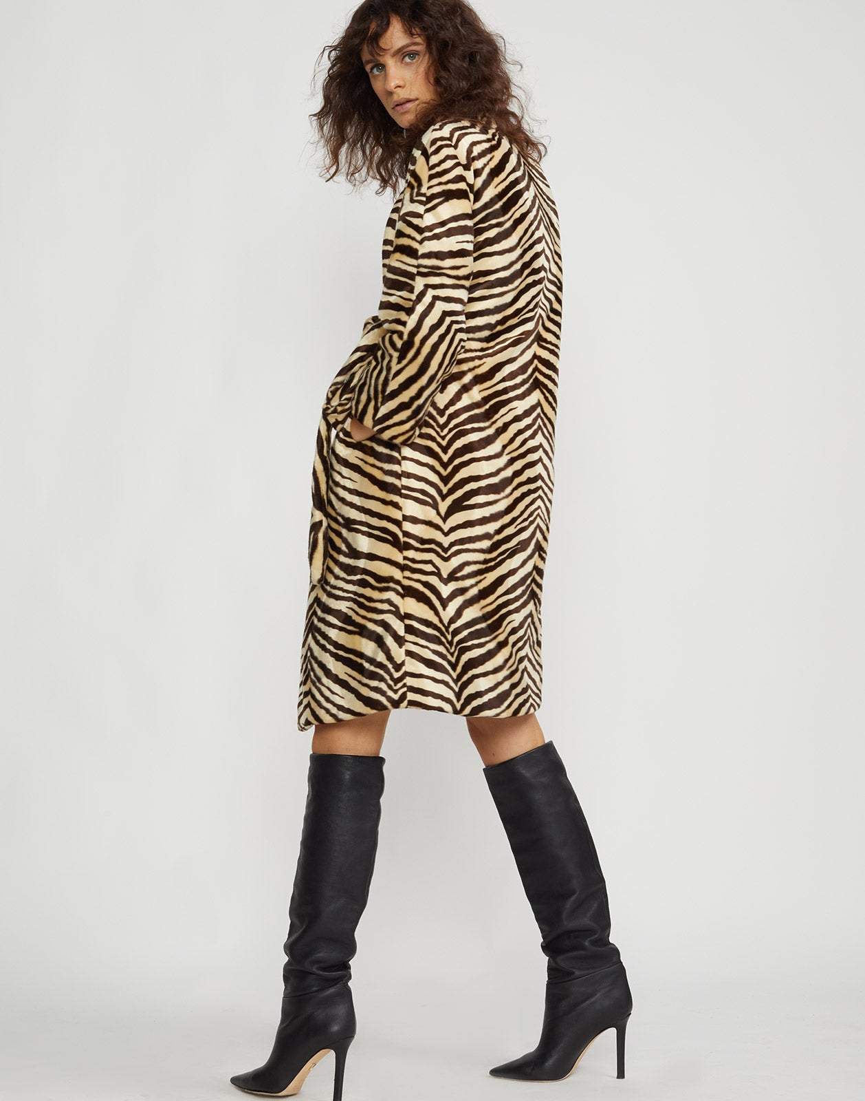 Back view of the faux fur zebra print coat.