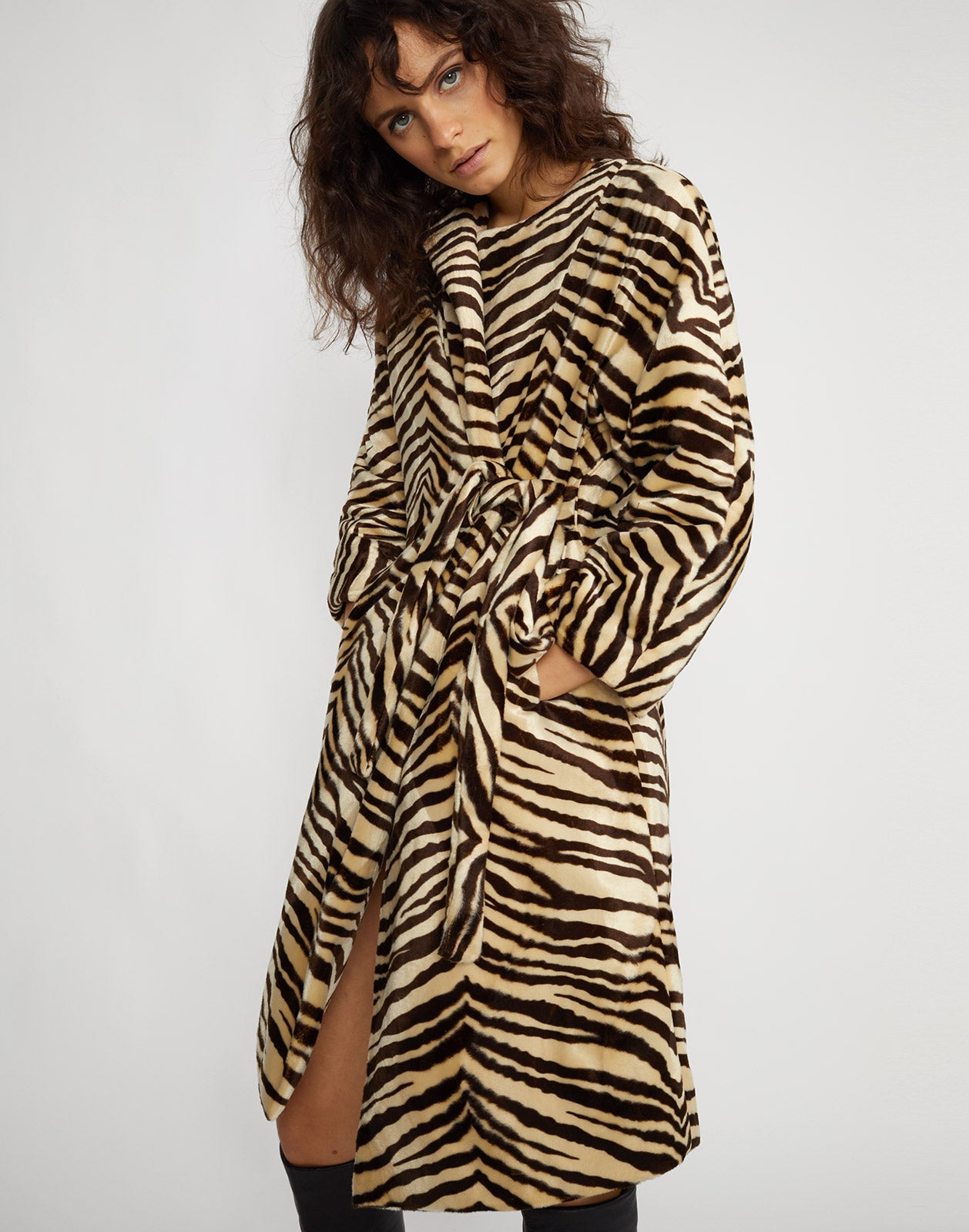 Close front view of the zebra print faux fur coat.