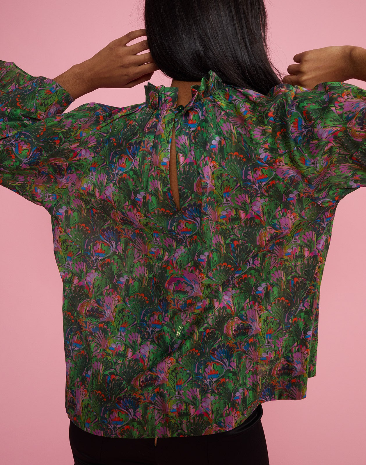 Back view of model wearing Marble Cotton Waterfall Blouse.