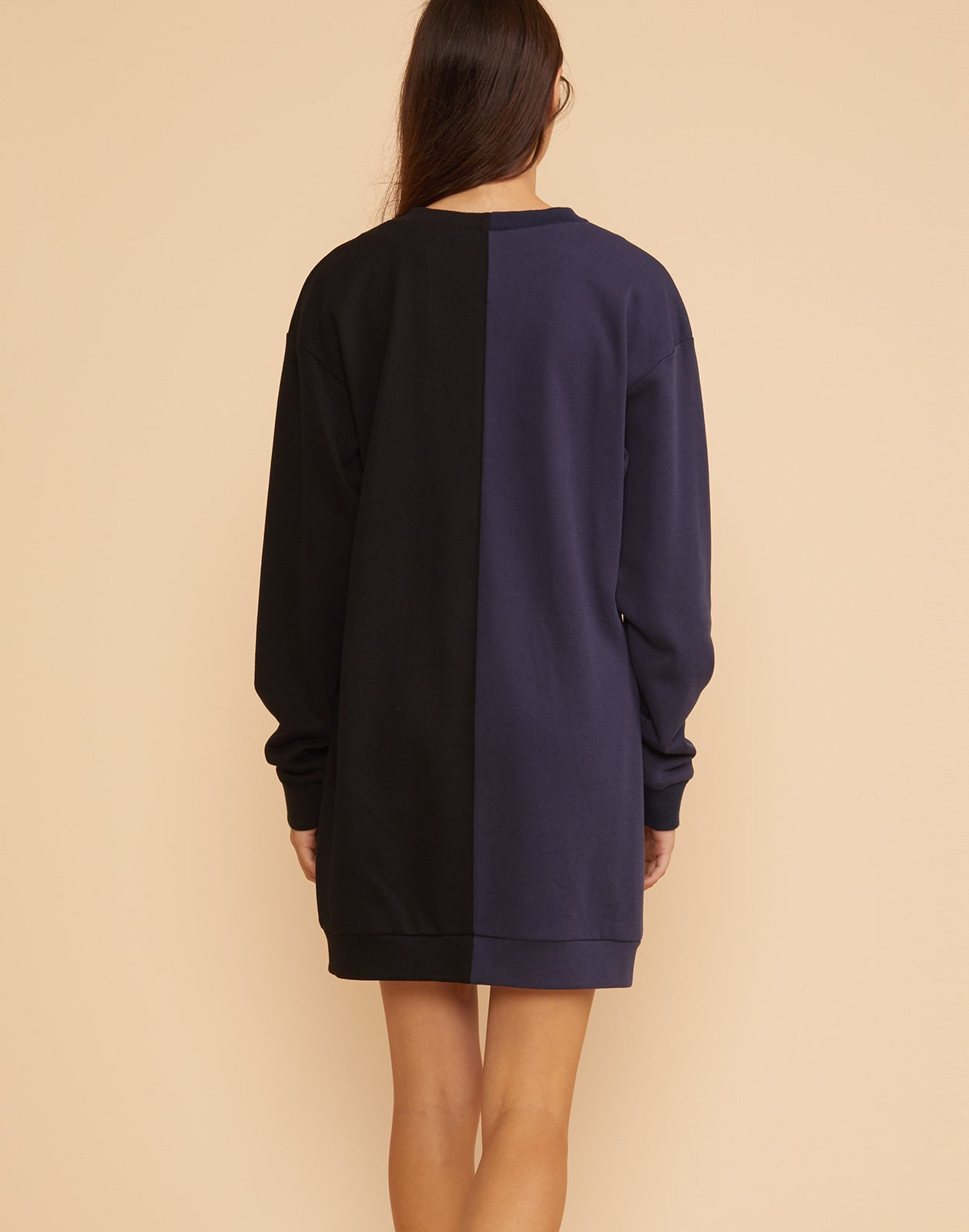 Back view of the CaliYork sweatshirt dress in half navy half black.