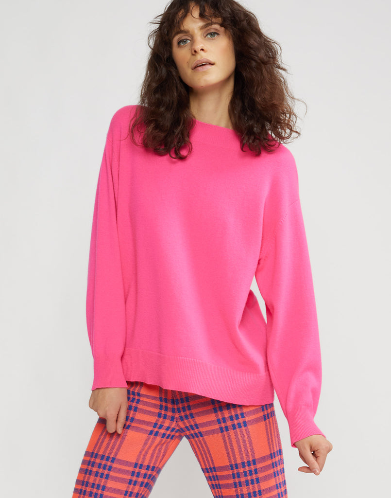 Front view of model wearing Anna cashmere sweater in fuchsia.
