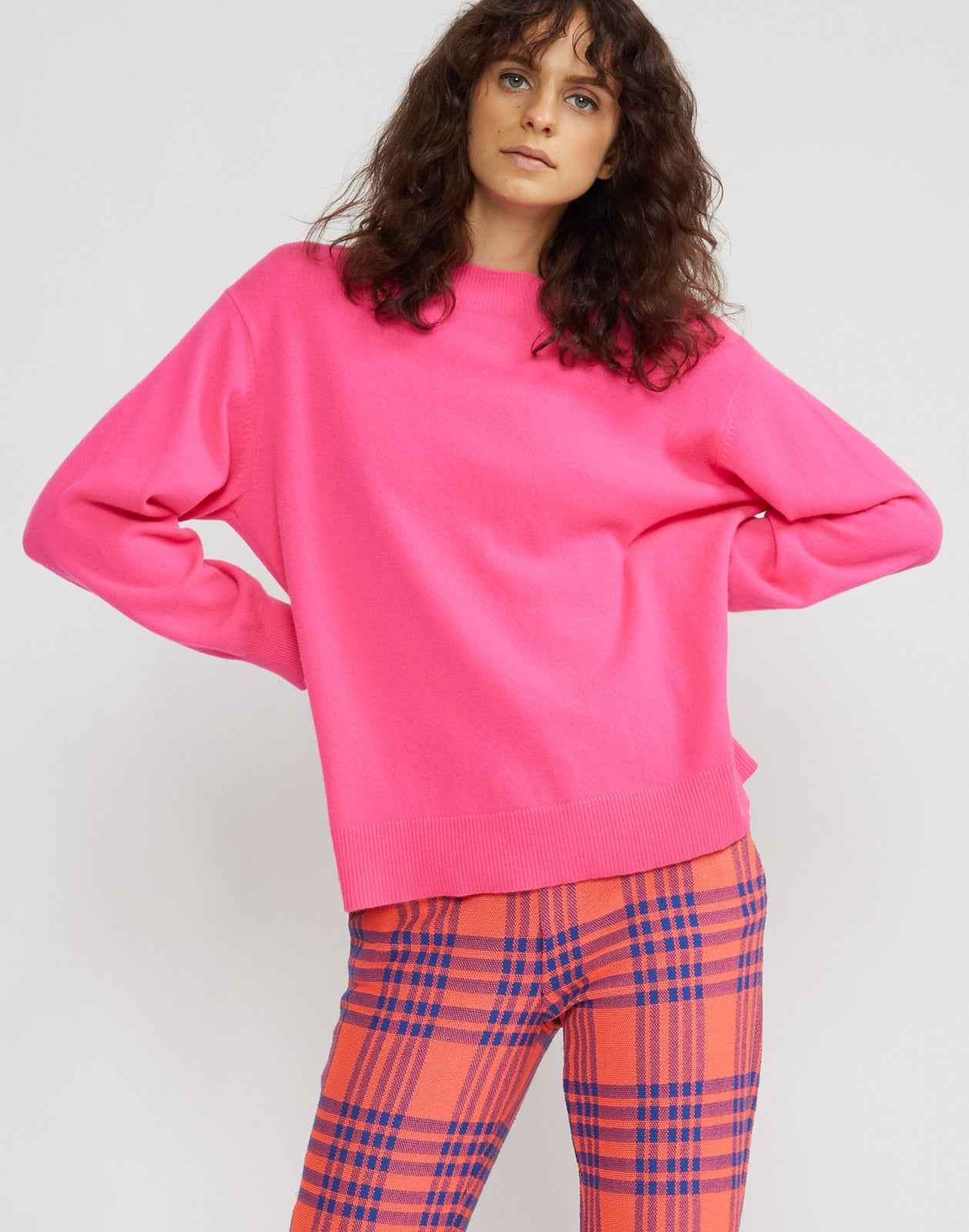 Alternate front view of model wearing Anna cashmere sweater in fuchsia.