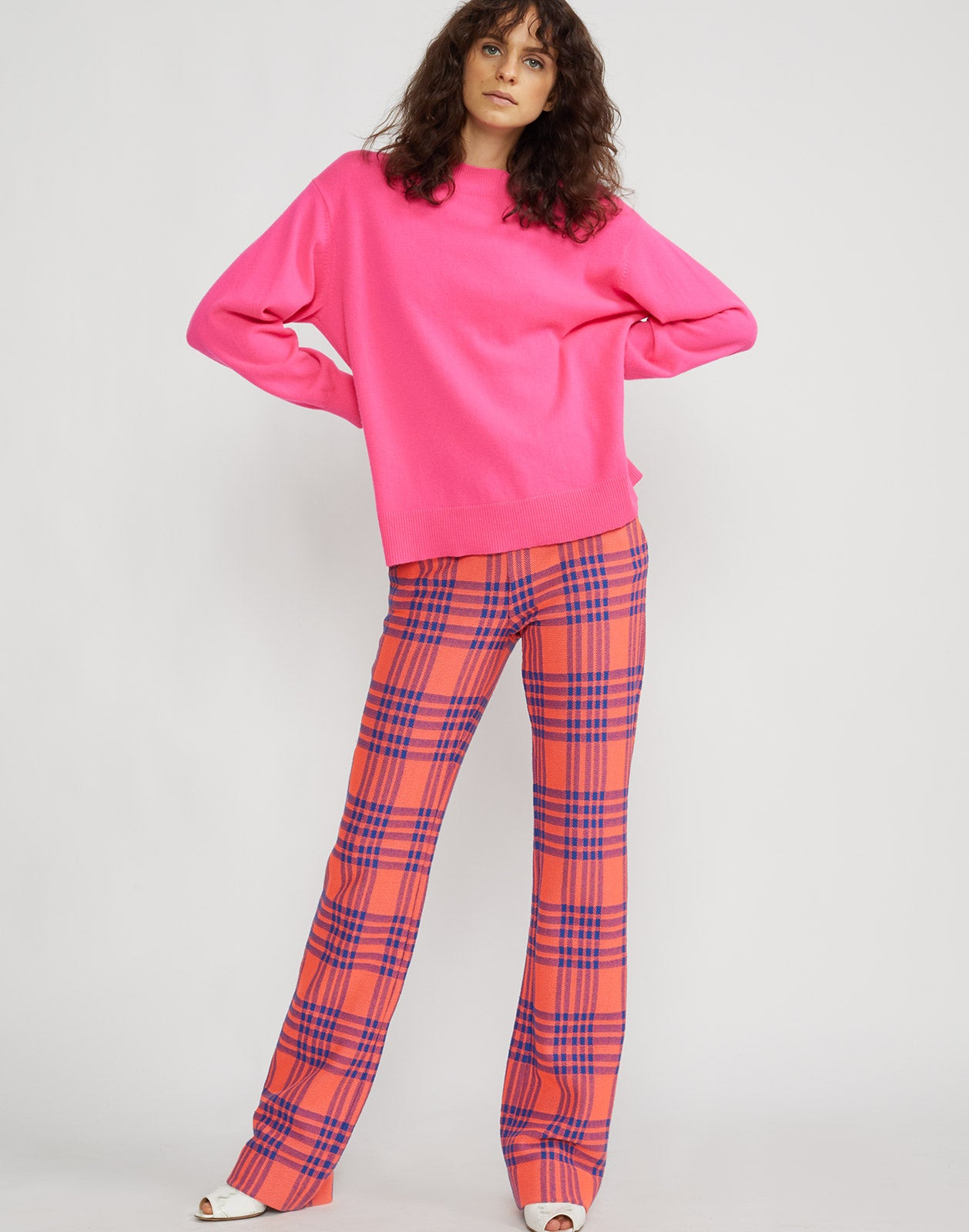Full front view of model wearing Carson stretch plaid pants.