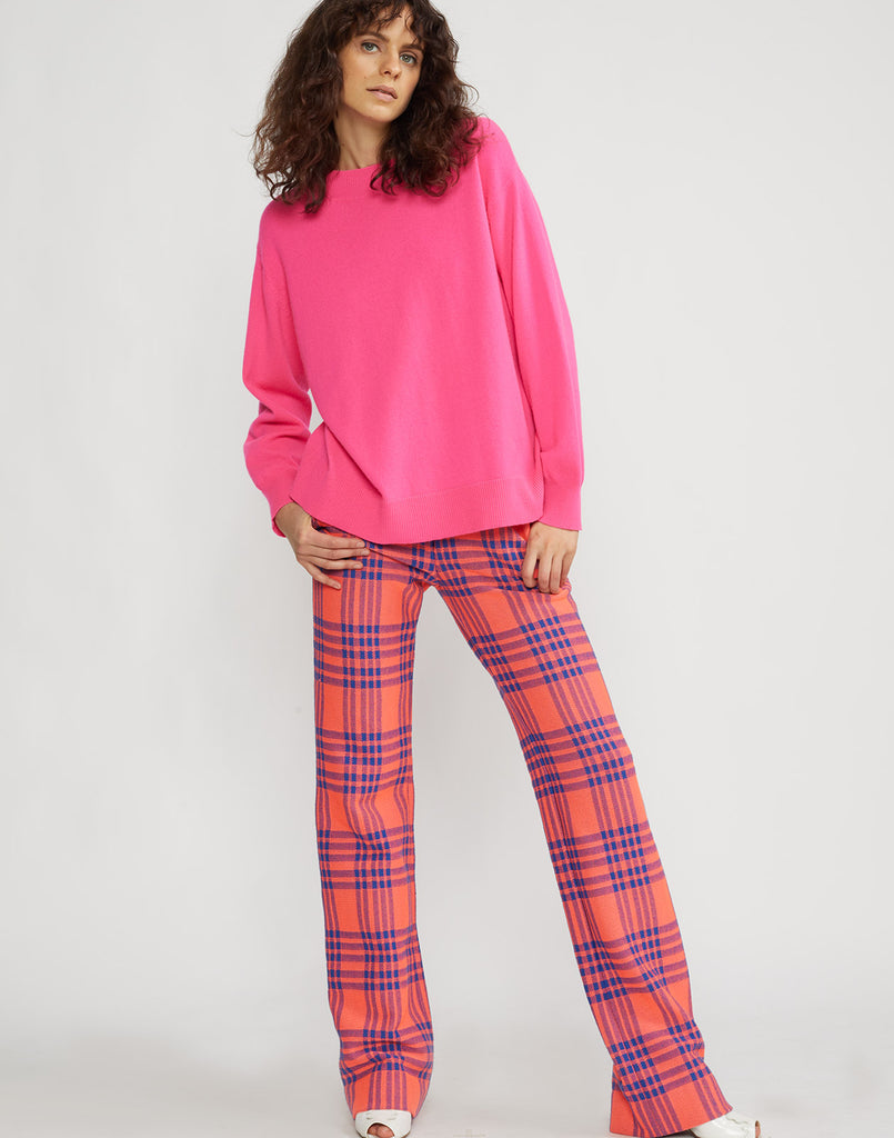 Alternate front view of model wearing Carson stretch plaid pants.