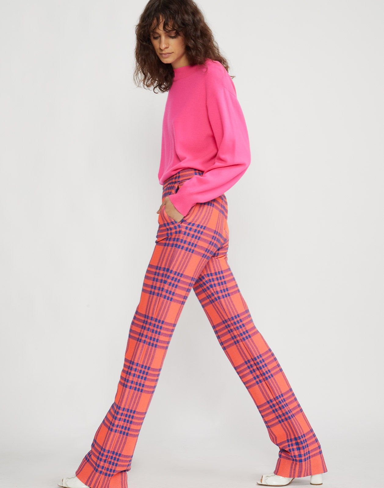 Side walking view of model wearing Carson stretch plaid pants.