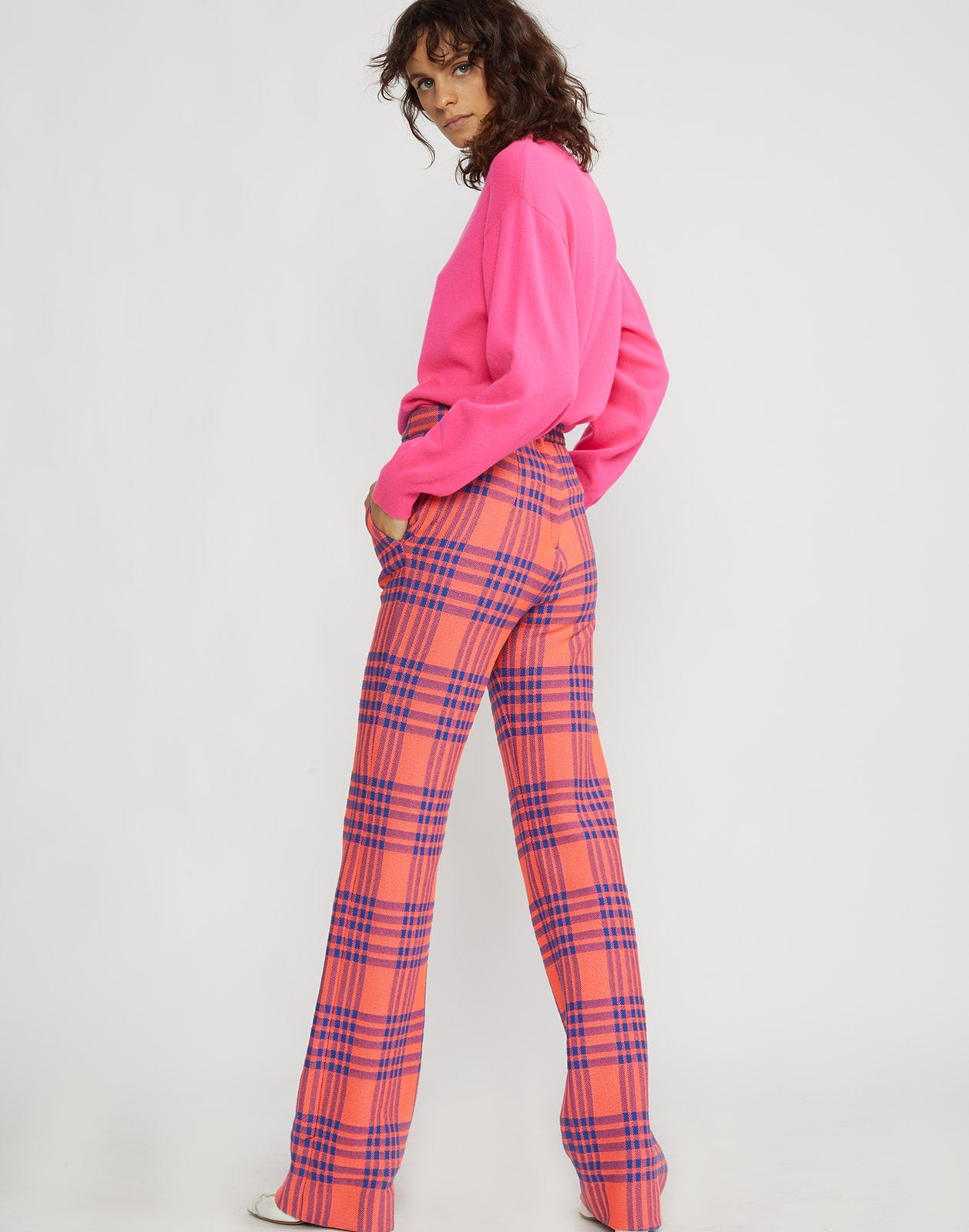 Full back view of model wearing Carson stretch plaid pants.