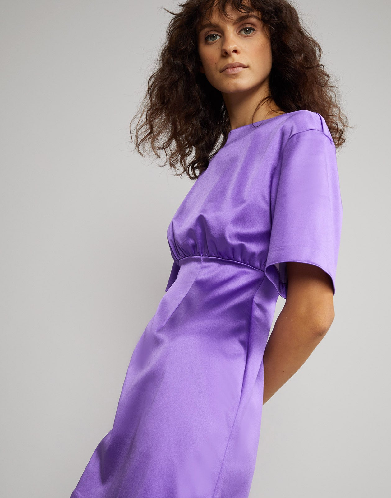 Close side view of the stretch satin mini dress in ultraviolet.