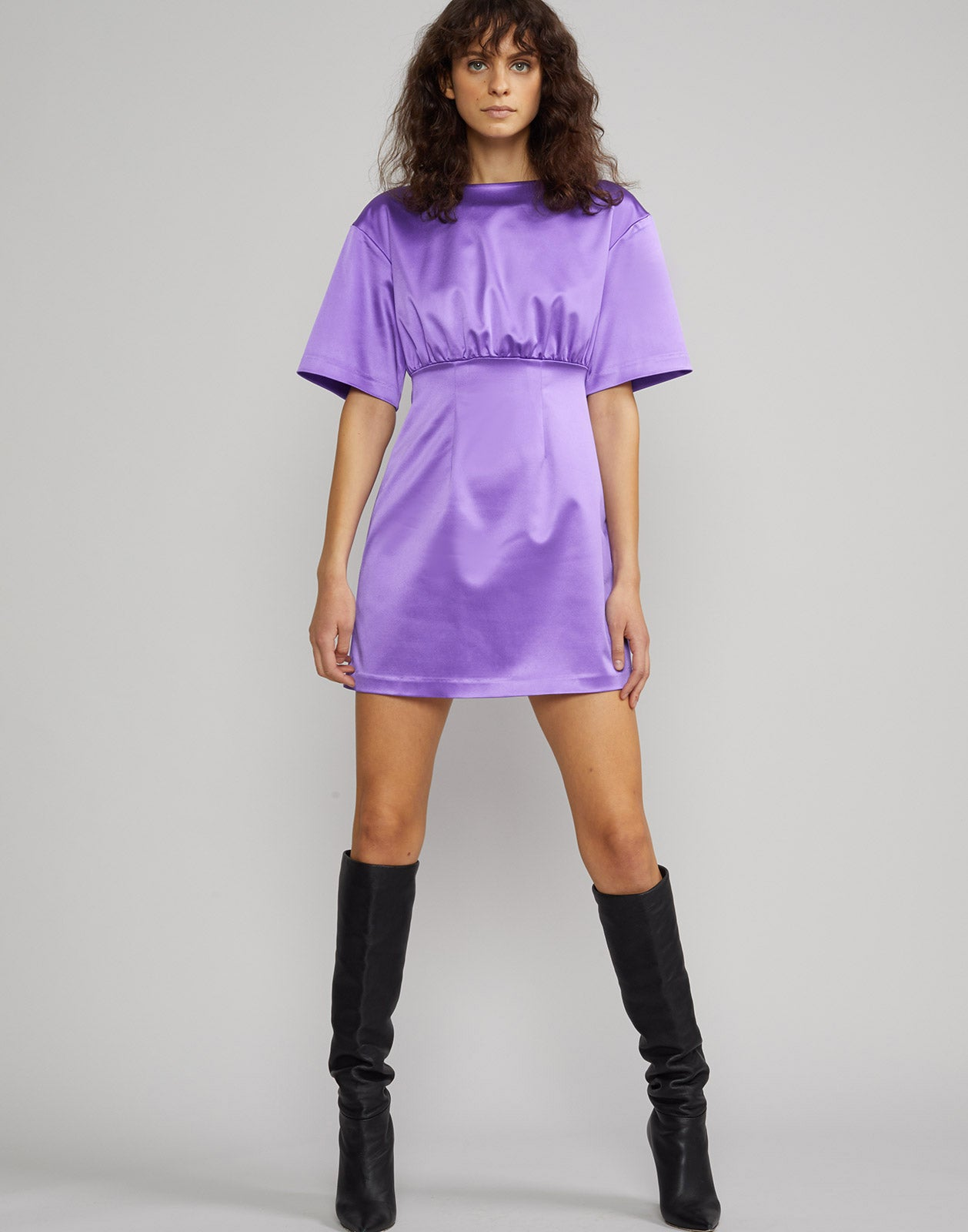 Front view of model wearing stretch satin mini dress in ultraviolet.