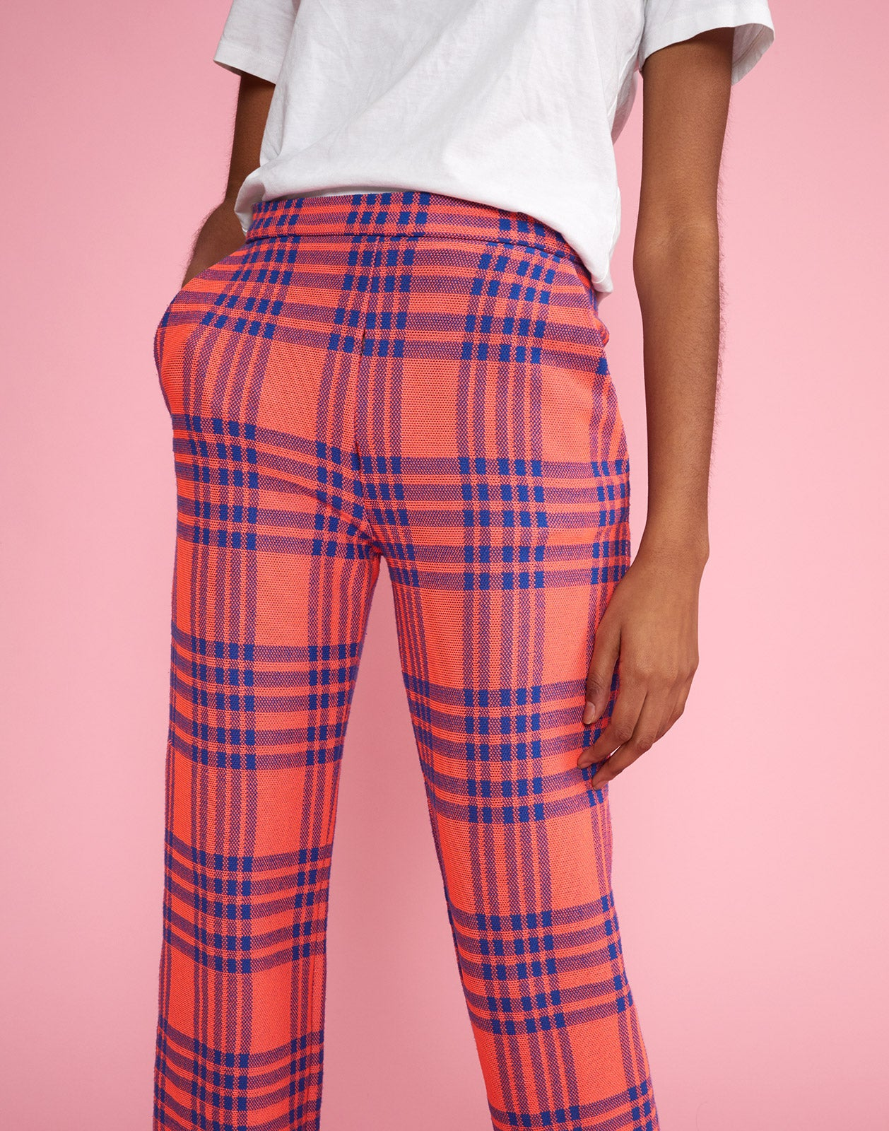 Close front view of model wearing Carson stretch plaid pants.
