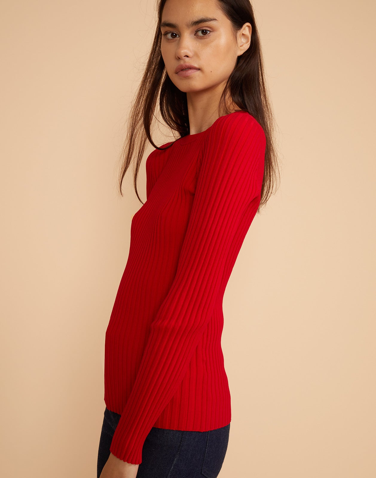 Side view of Haven ribbed sweater in red.