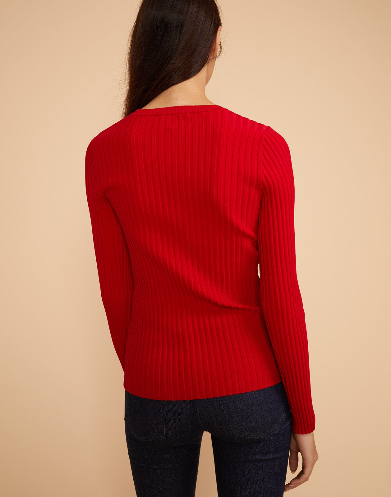 Back view of Haven ribbed sweater in red.