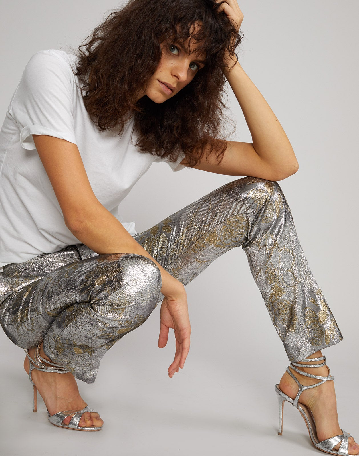 Model posing in the Gold Coast metallic brocade pant