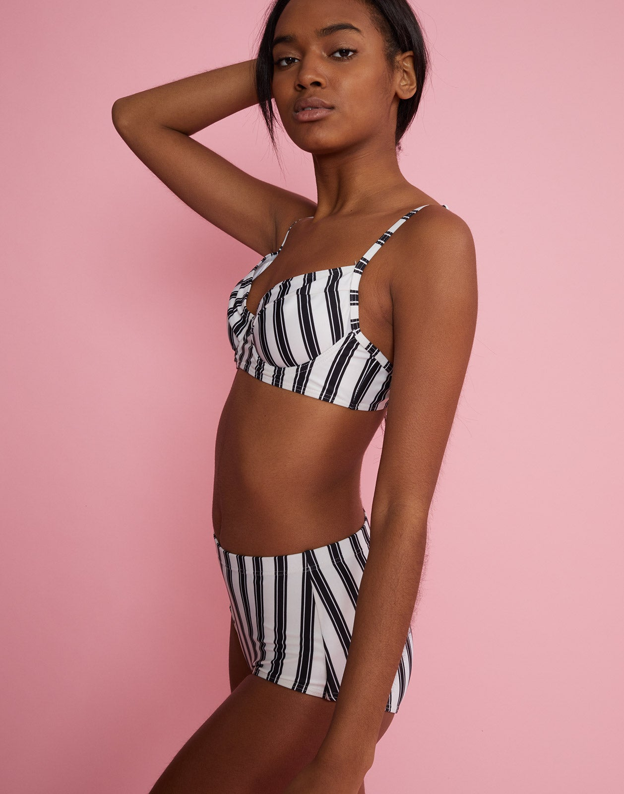Side angled view of high rise bikini bottom with black and white stripes