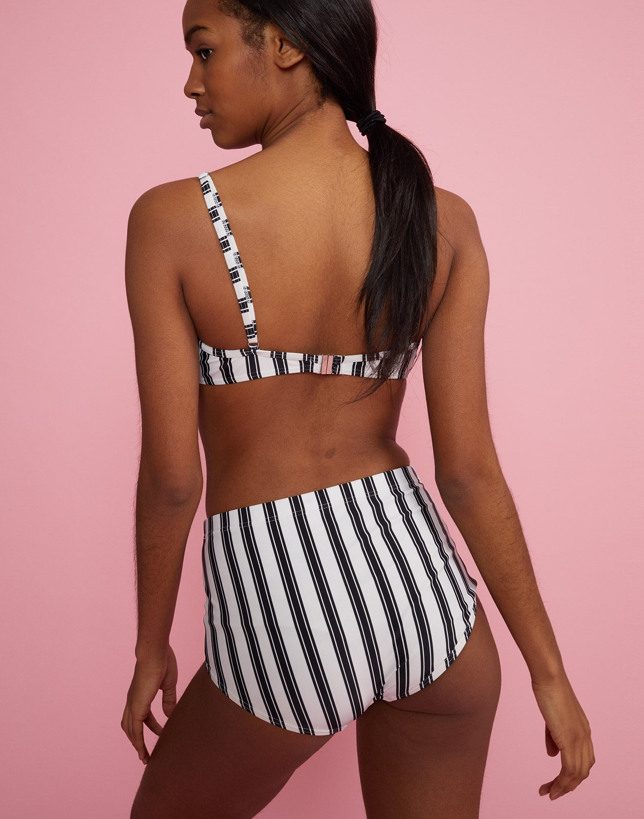 Back view of high rise bikini bottom with black and white stripes