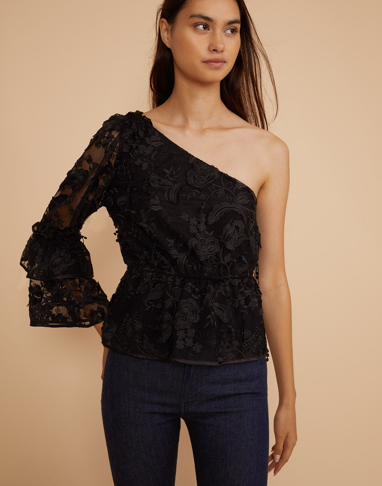 Front view of model wearing Beatrix one sleeve lace top.