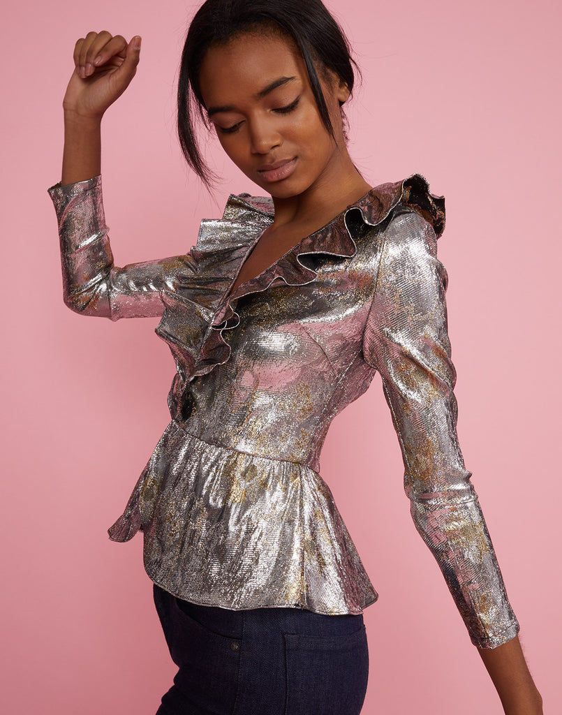 Side view of model wearing Gold Coast Metallic Brocade Ruffle Top.