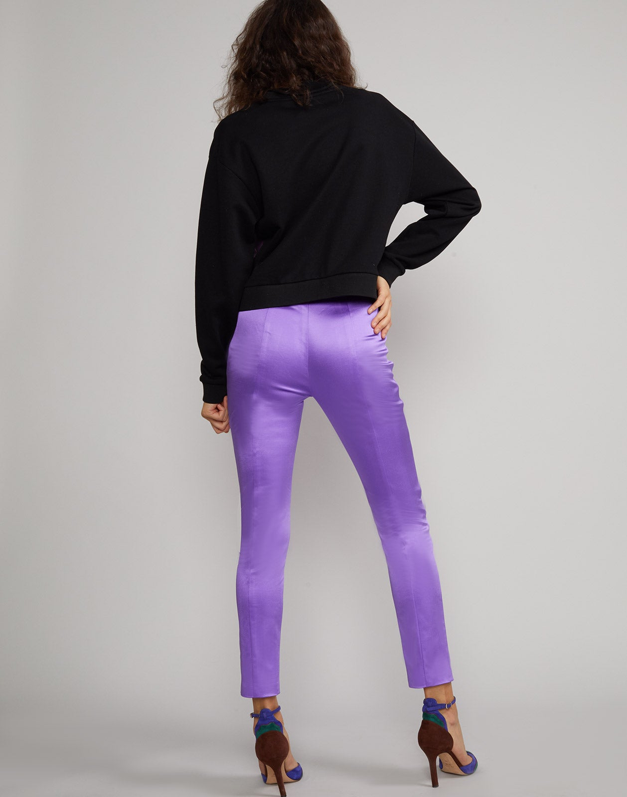 Back view of model wearing Rush stretch satin pant in ultraviolet.