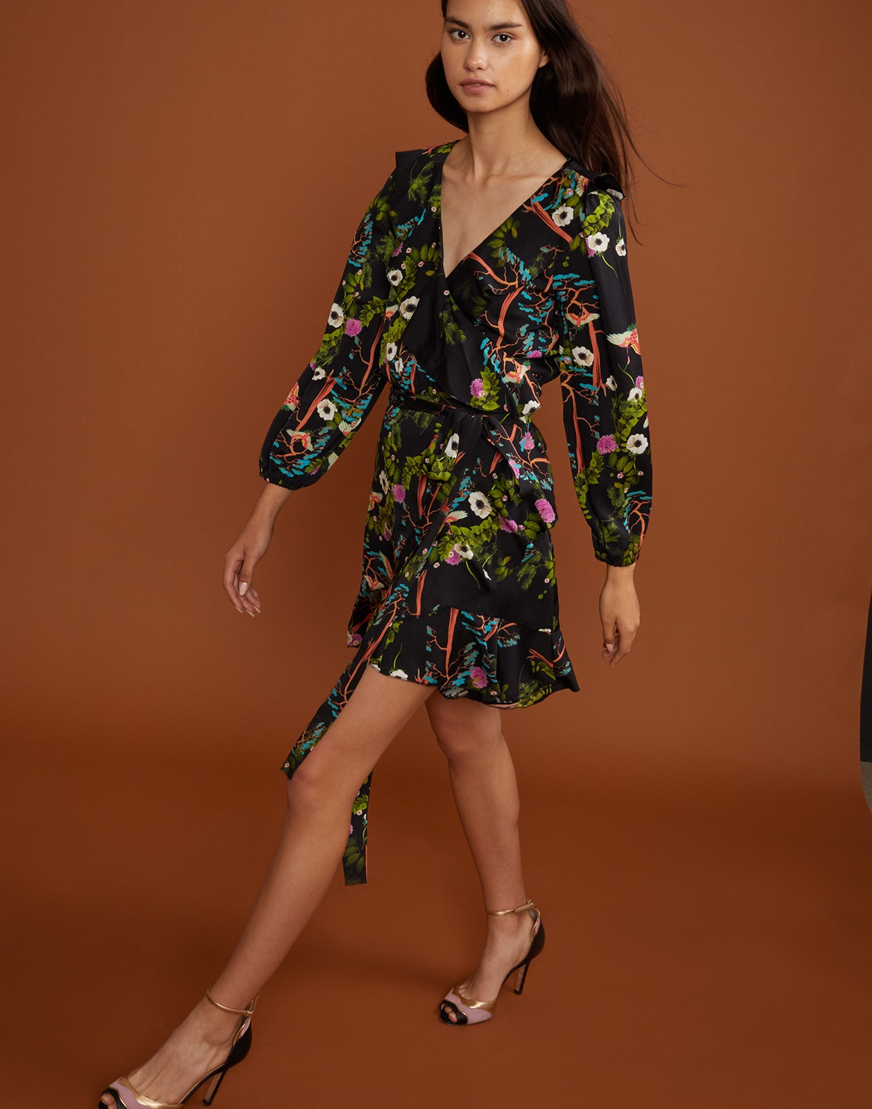 Front view of Malibu wrap dress in vibrant dark floral print.