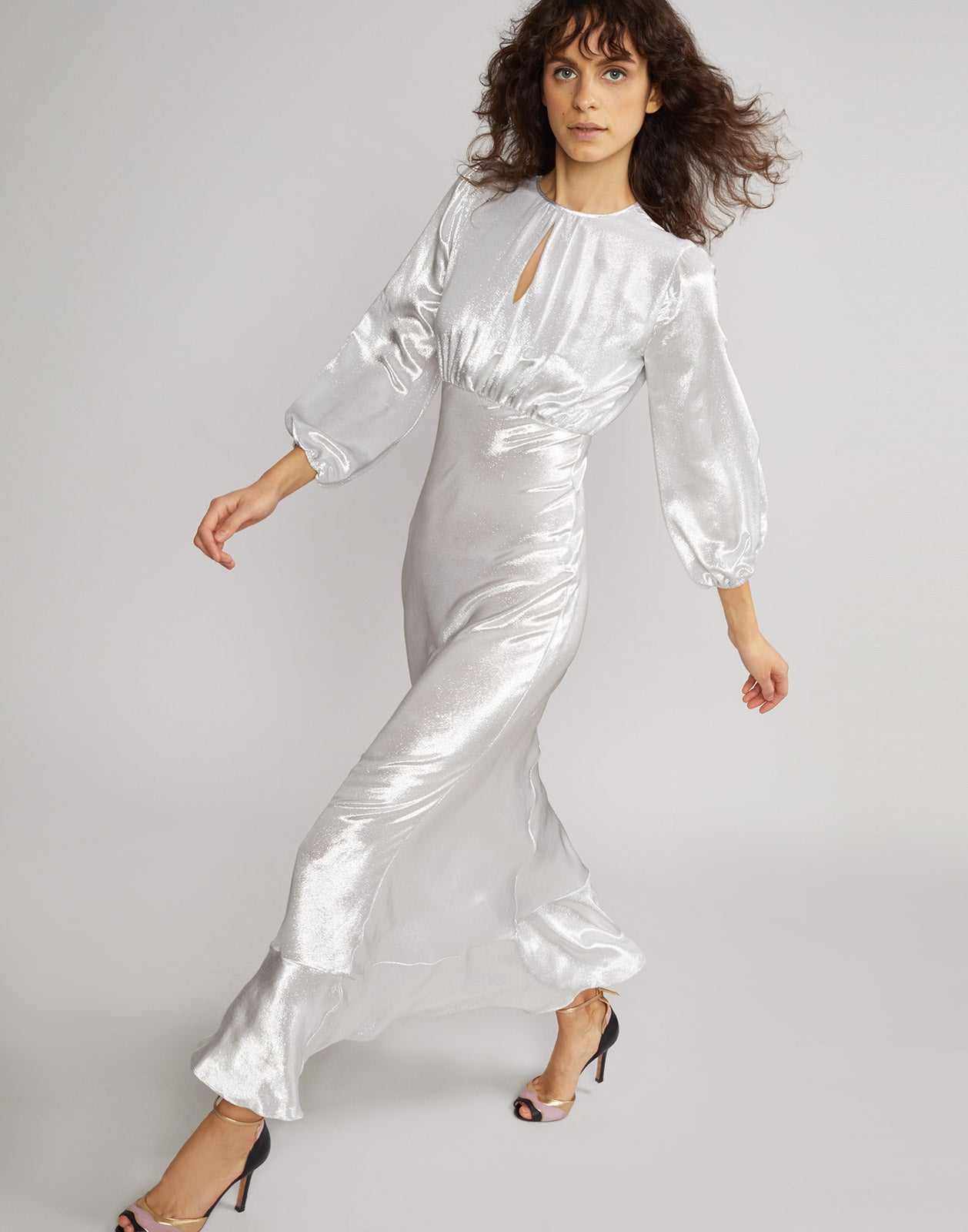 Side view of model wearing Silver Lake Metallic Maxi Dress.