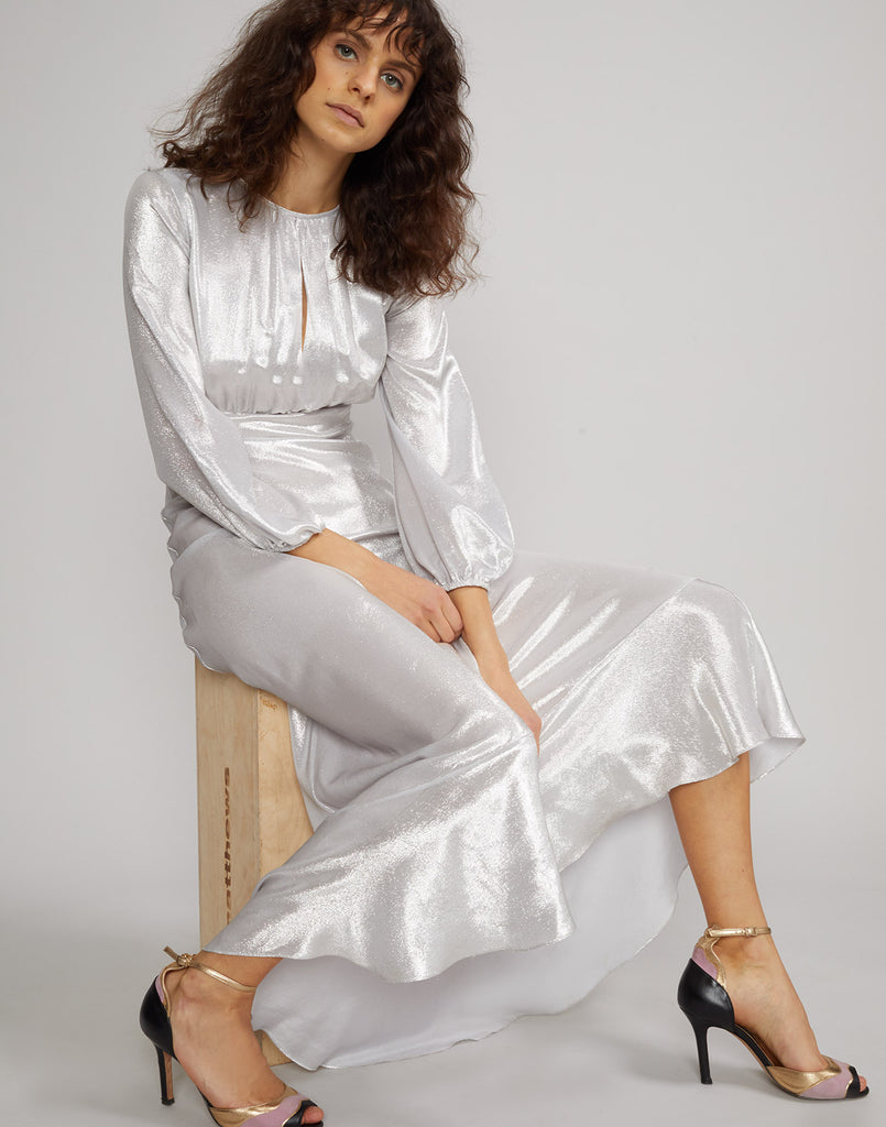 Seated view of model wearing Silver Lake Metallic Maxi Dress.