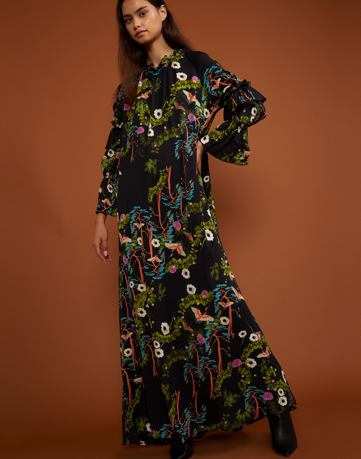 Side view of the dark floral Allegra maxi dress.